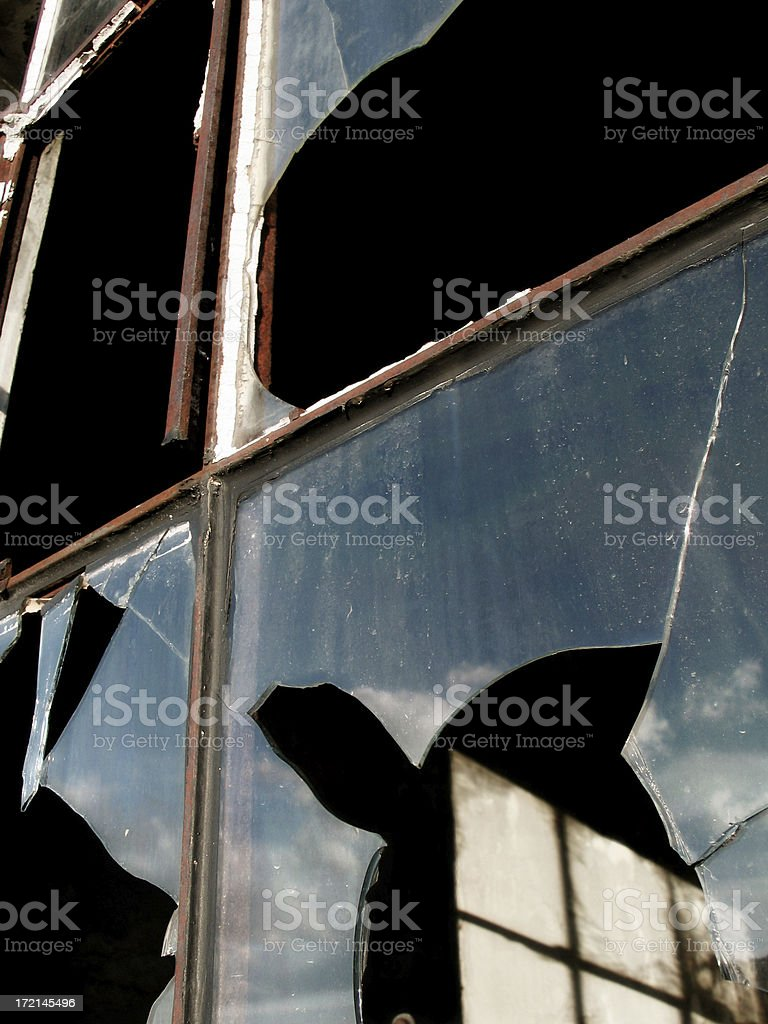 Reflection of sky in broken window royalty-free stock photo