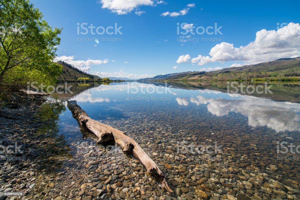 Reflection of Still water at Lake Dunstan, South Island, New Zealand. stock photo