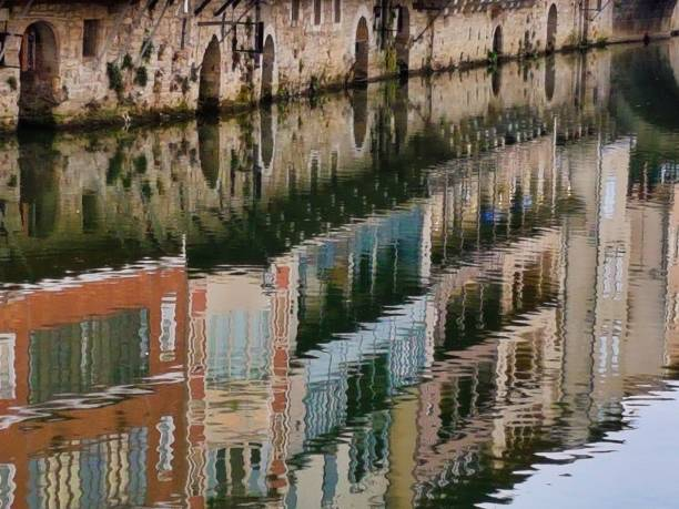 Reflection of tanners' houses in the Agout River, Castres, France stock photo