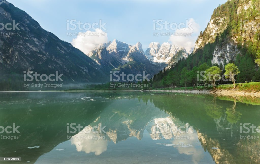 Reflection of the Dolomites in Lake stock photo