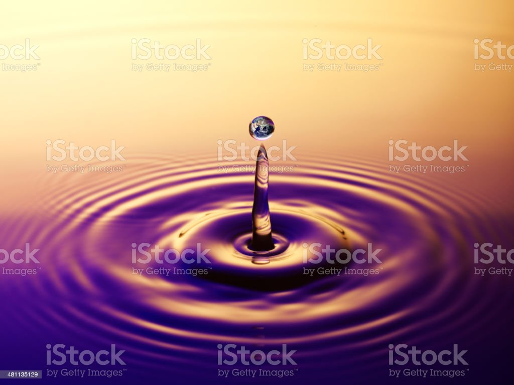 Reflection of the Earth in a Raindrop Splash royalty-free stock photo