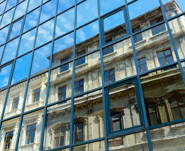 reflection of the old house and the sky with clouds - historic vs new stock photos and pictures