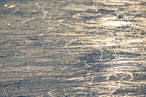 Reflection of the setting sun on the surface of the ice rink. Texture and backgrounds stock photo