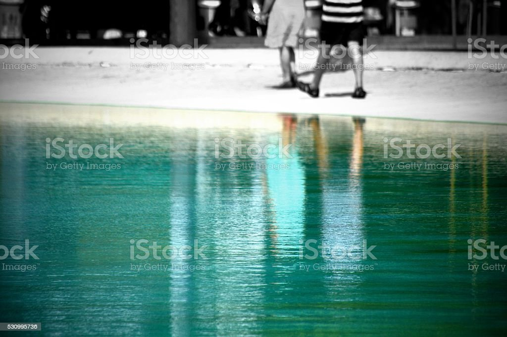 Reflection of the silhouette of an older couple stock photo
