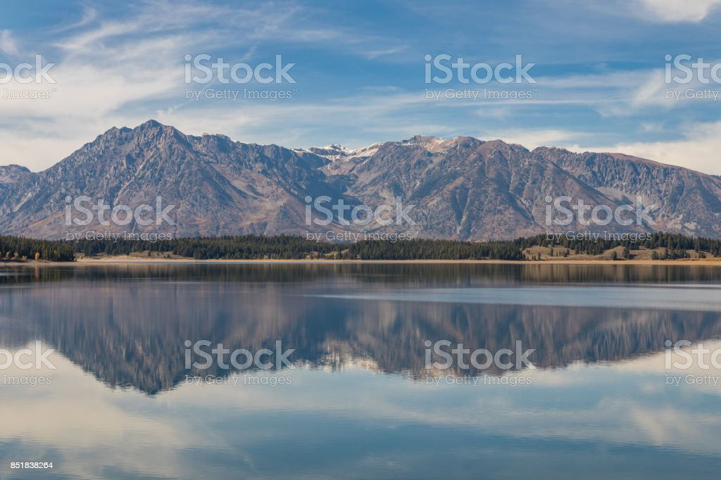 Reflection of the Tetons in Jackson Lake stock photo