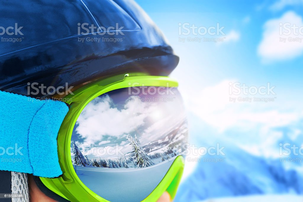 Reflection of the winter mountain landscape in a ski mask. stock photo