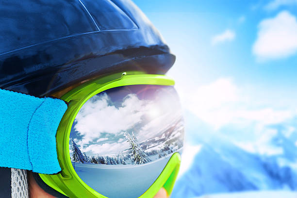 Reflection of the winter mountain landscape in a ski mask. Reflection of the winter mountain landscape in a ski mask. Shallow depth of field. ski goggles stock pictures, royalty-free photos & images
