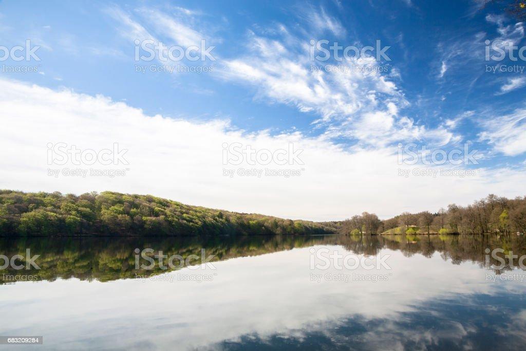 reflection of trees and sky i lake stock photo