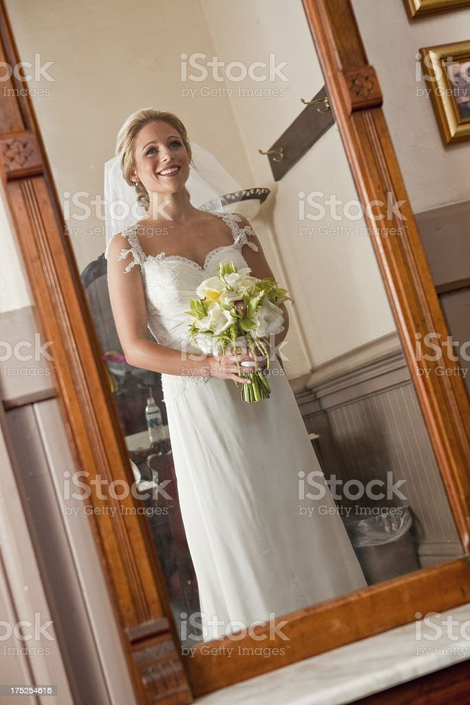 Reflection of Wedding Day Bride in Traditional White Dress royalty-free stock photo