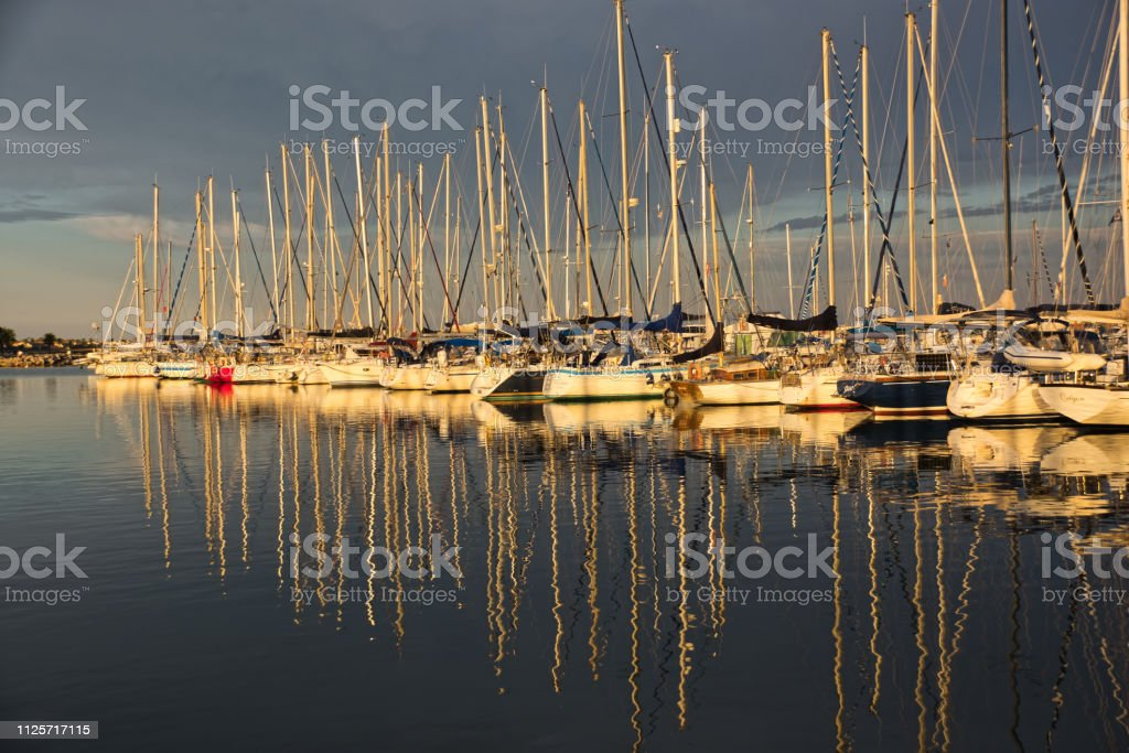 Reflection of  yachts stock photo