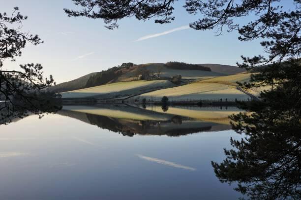 Reflection on Glencorse reservoir stock photo