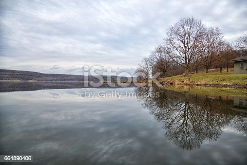 Perfectly symmetric reflections on Lake Arthur in Pittsburgh PA, USA.