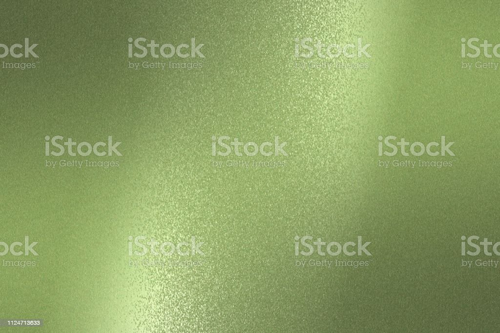 Reflection on rough light green metallic sheet surfaces, abstract texture background stock photo