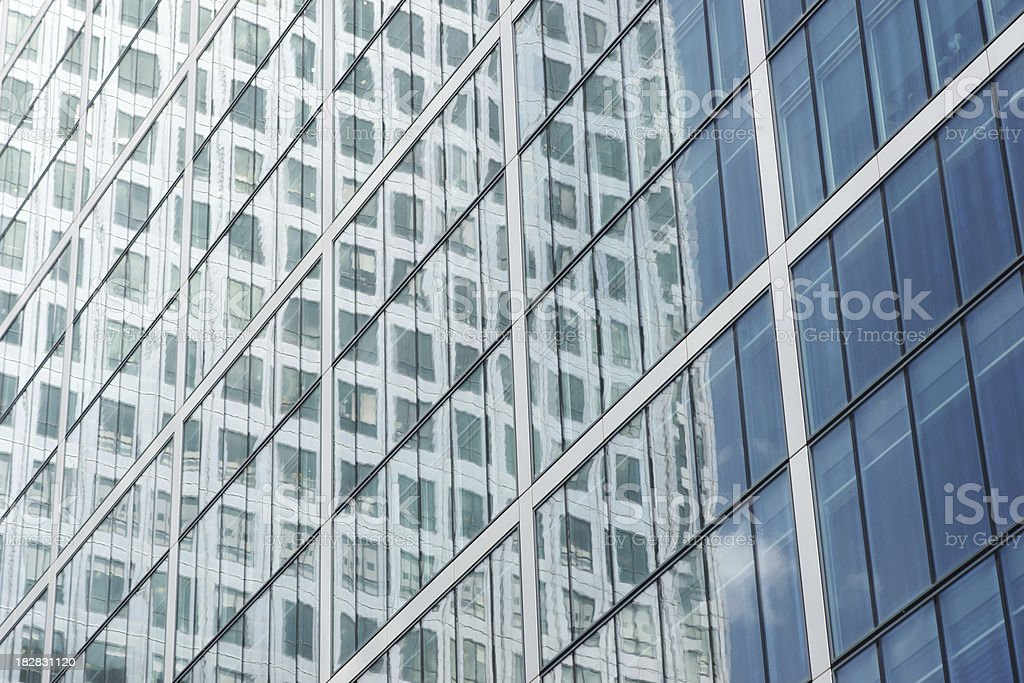 Reflection on the high-rise glass building royalty-free stock photo