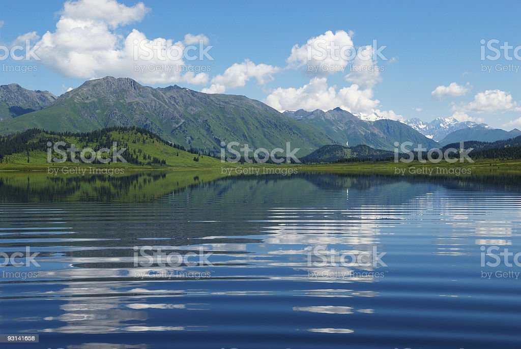 Reflection on wave in lake stock photo