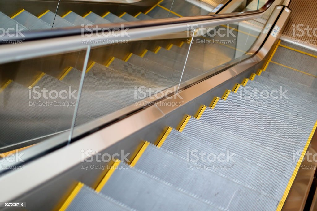Reflection pattern of Electric Escalator in metro. moving up...