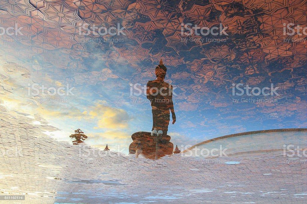 Reflection shadow of Buddha statue at Phutthamonthon stock photo
