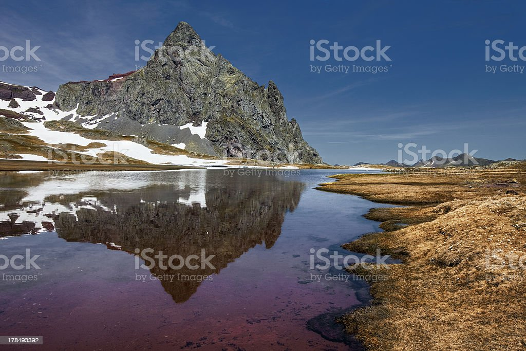 Reflections Anayet peak in the aragoneses Pyrenees stock photo