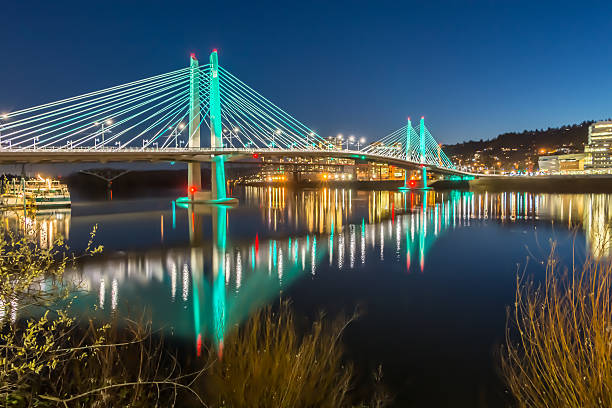Reflections Illuminated Tilikum Crossing  Portland Oregon Willamette River Evening HDR stock photo