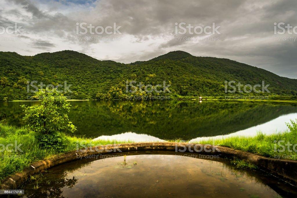 Reflections in a beautiful Dam in Goa stock photo
