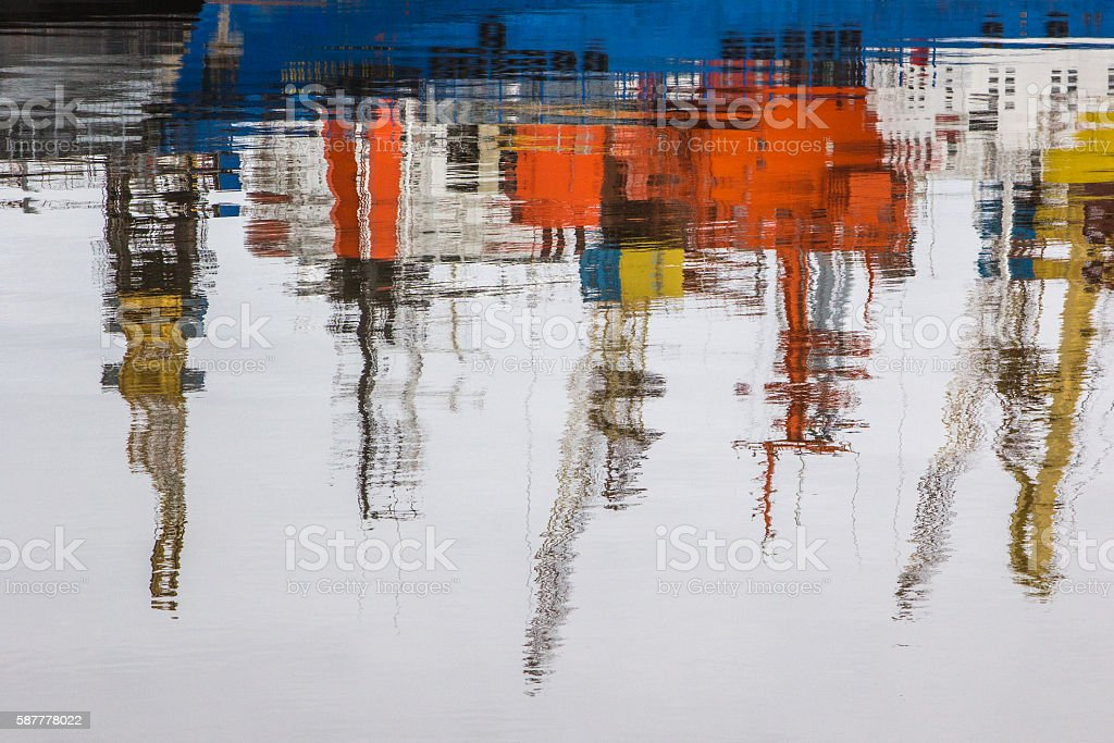 Reflections in a harbor stock photo