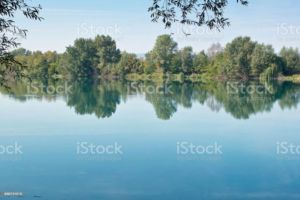reflections in a small lake stock photo