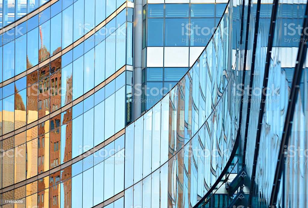 Reflections in Glass Facade of Modern Office Building royalty-free stock photo
