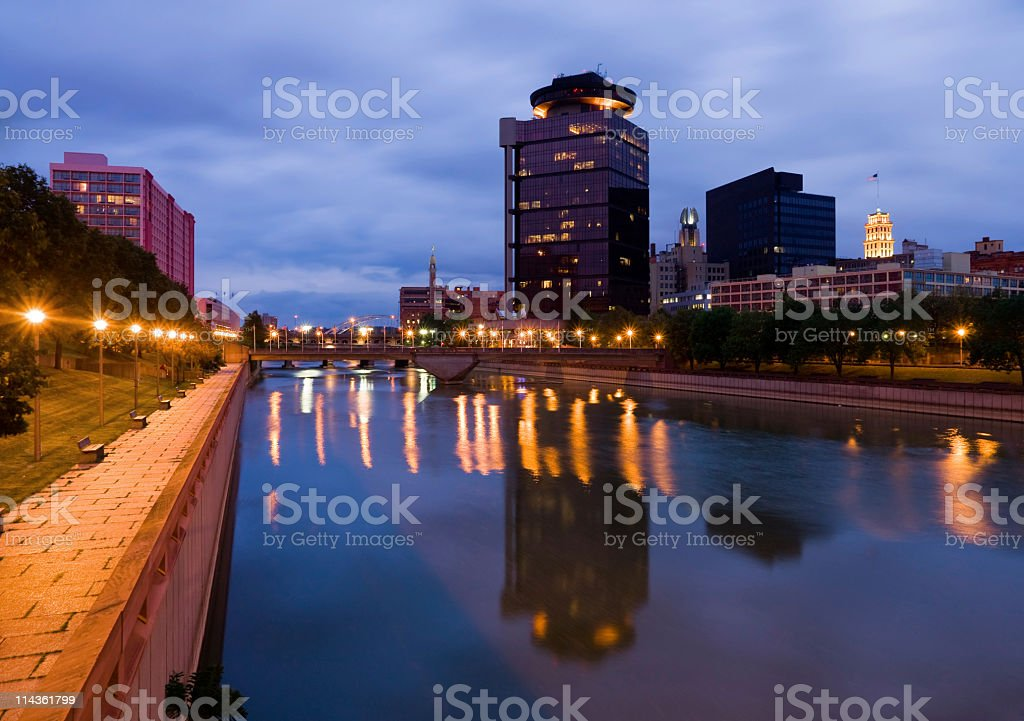 Reflections in river at Twilight in Rochester, New York stock photo