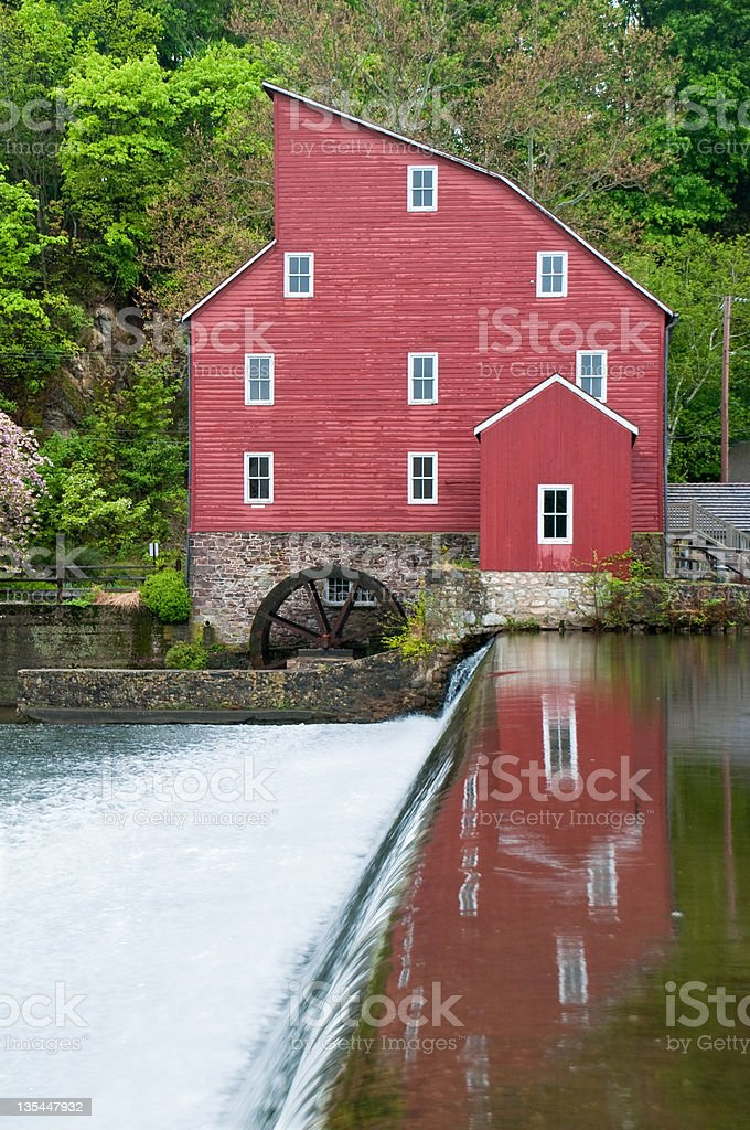 Reflections of an old red mill stock photo