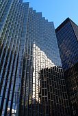 Toronto, Ontario, Canada - July 1, 2014: A view from below of office buldings in the Financial District of Toronto (Canada) with Golden Royal Plaza Building in the center