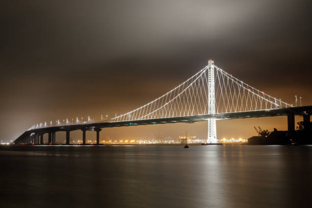Reflections of fog and water on the Bay Bridge eastern span on a summer night. stock photo
