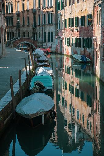 Reflections of gondolas in Venice