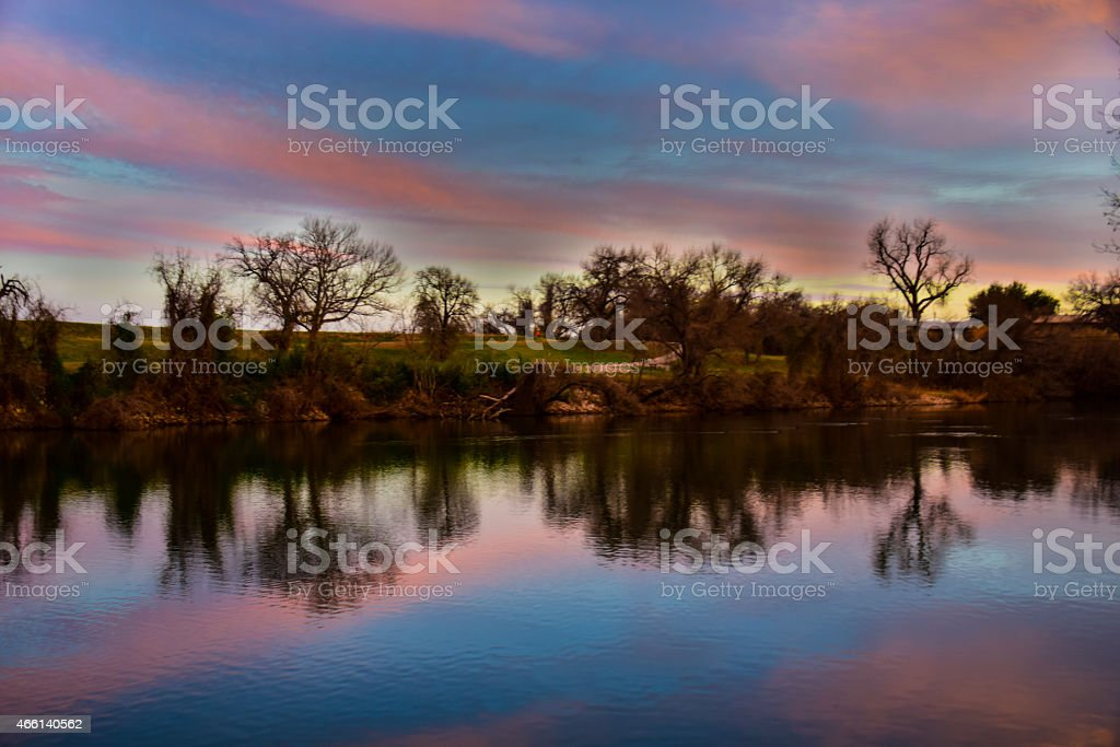 reflections of lake LBJ at Travis lake mirror image stock photo