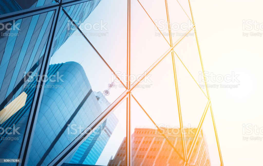 Reflections of modern commercial buildings on glasses with sunlight royalty-free stock photo