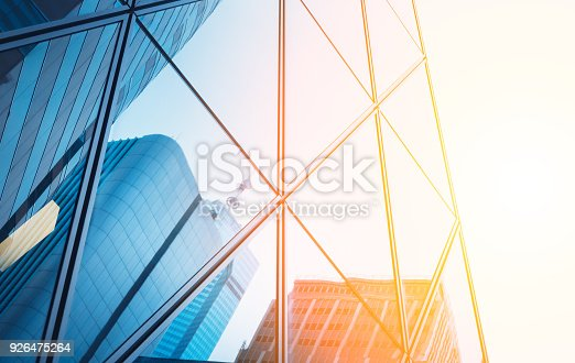 istock Reflections of modern commercial buildings on glasses with sunlight 926475264