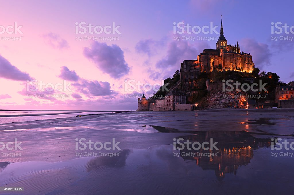 Reflections of Mont Saint-Michel Lit in the Evening stock photo