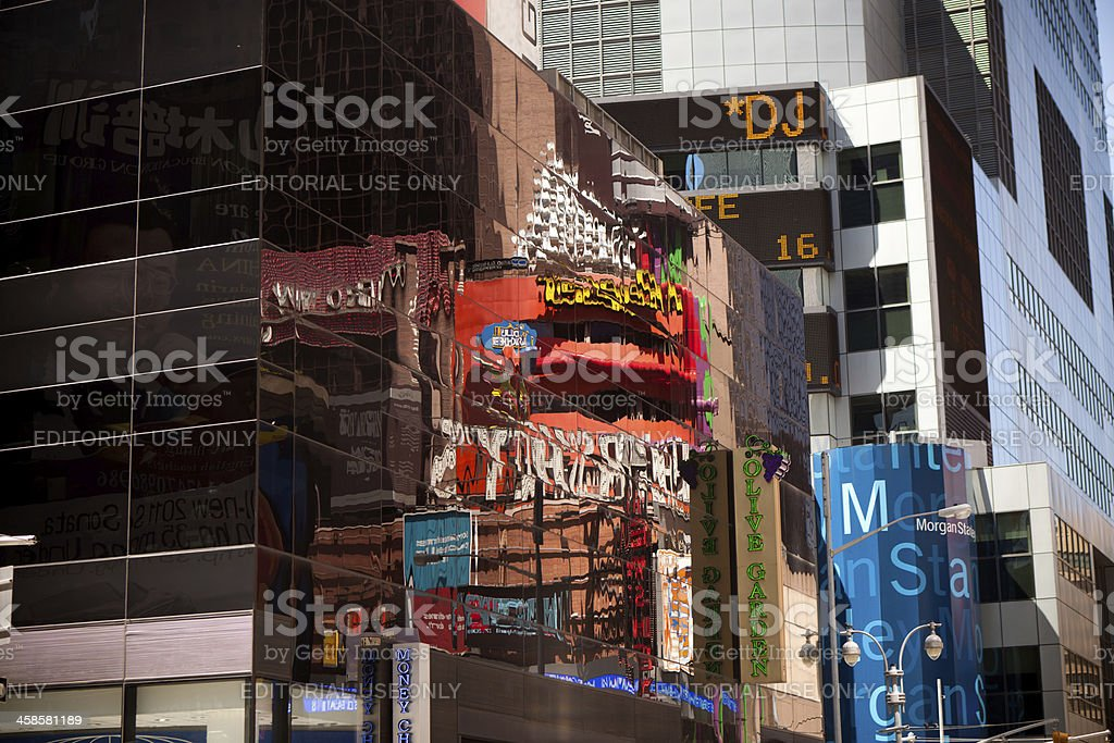 Reflections of signs in Times Square stock photo