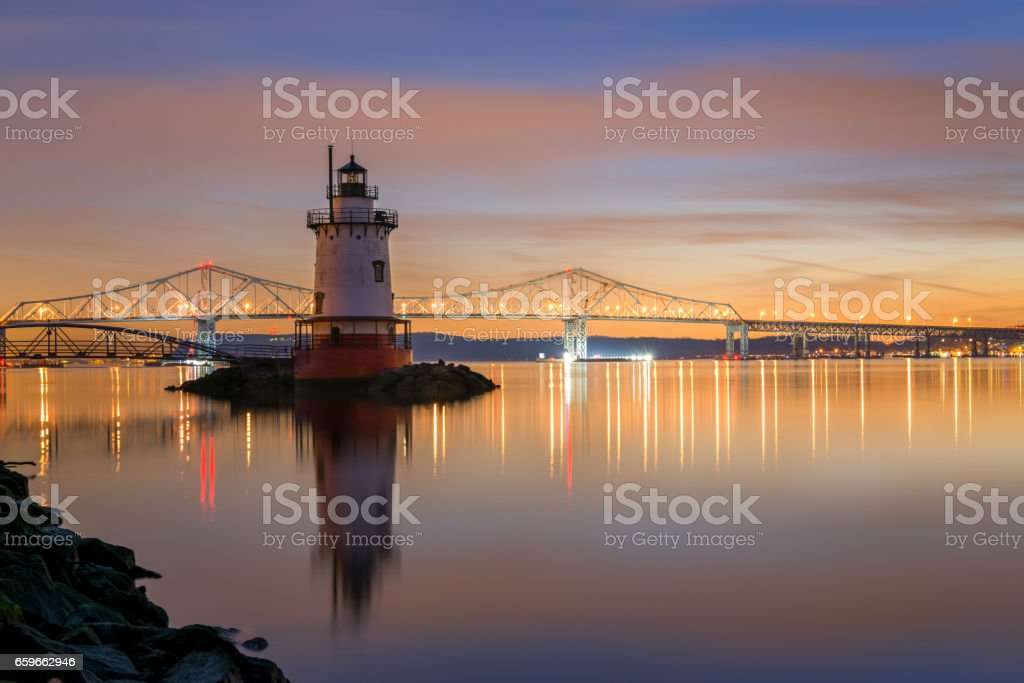Reflections of Sleepy Hollow Lighthouse at night stock photo