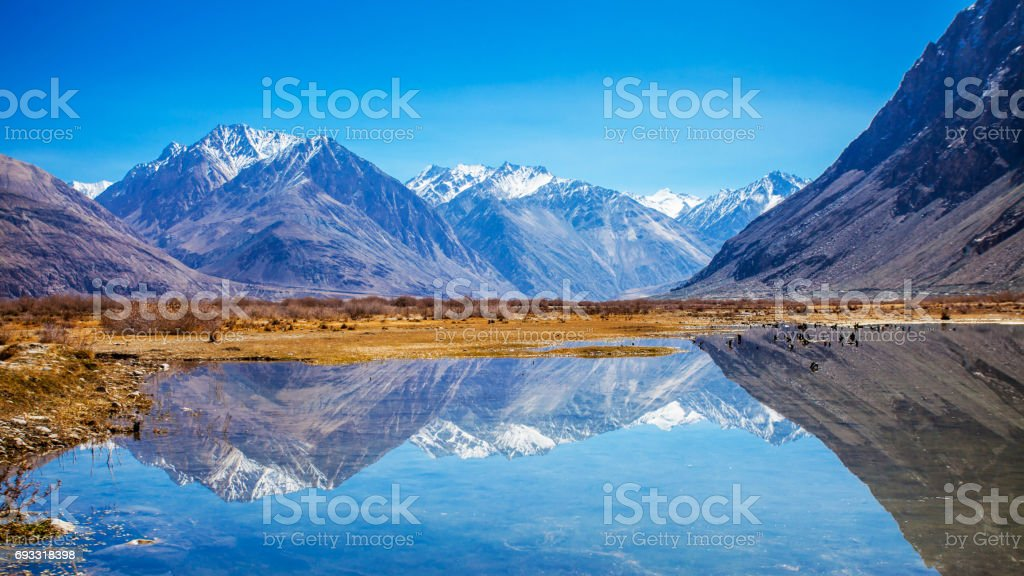 Reflections of Snow mountains in the lake stock photo