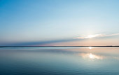 istock Reflections of sunset with cloudscape in lake water 1182434606