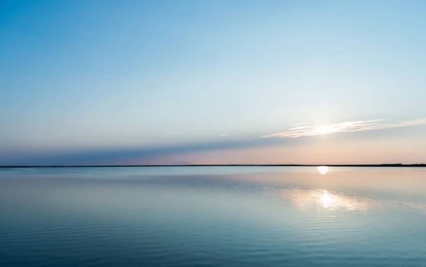 Reflections of sunset with cloudscape in lake water Reflections of sunset with cloudscape in lake water. tranquil scene stock pictures, royalty-free photos & images