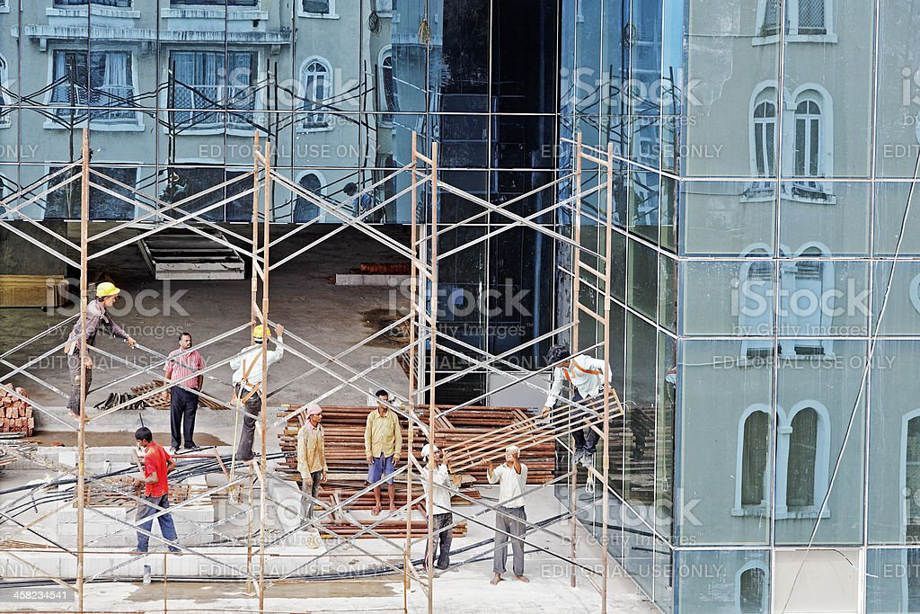Reflections of the scaffolding and workers royalty-free stock photo