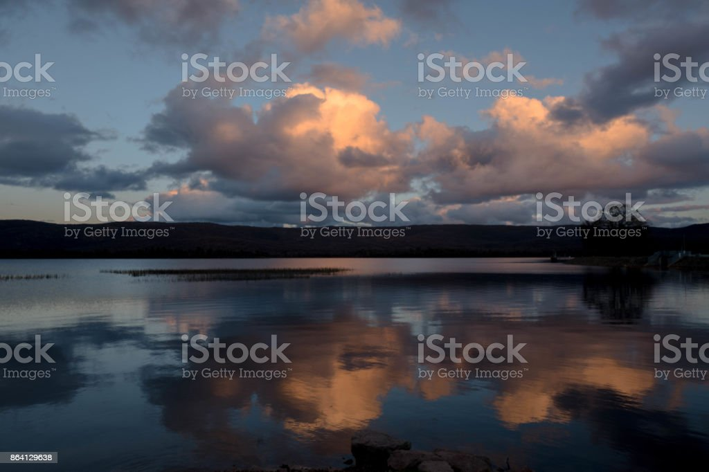 Reflections of the sky in the lake like a mirror royalty-free stock photo