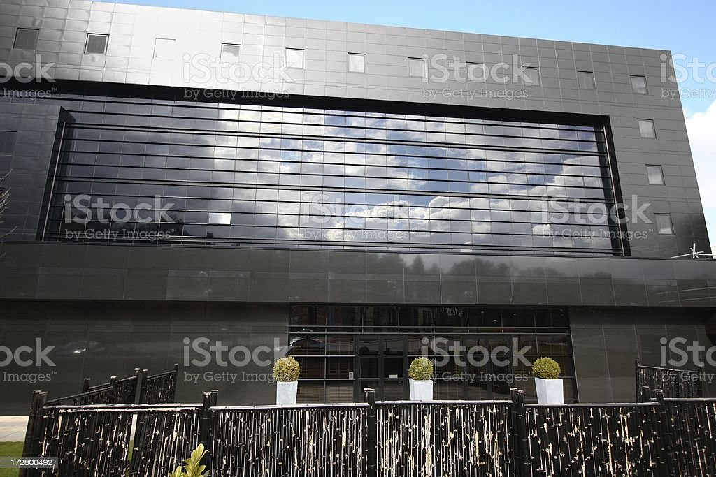 Reflections on a black granite and glass building royalty-free stock photo