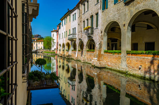 Reflections on the Buranelli canal in Treviso (Veneto, Italy). stock photo