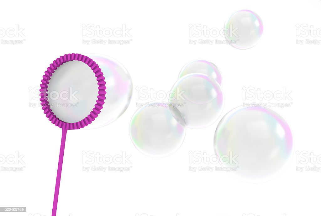 Reflective bubbles being blown from a children's toy stock photo