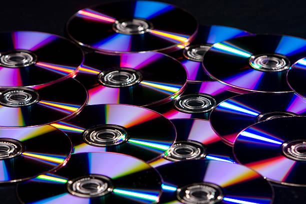 réflexion de cd, lecteur dvd, lecteur blu-ray - blu ray disc photos et images de collection