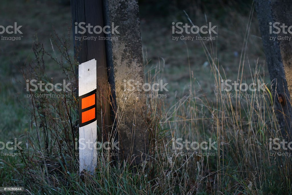Reflective delineator in the spotlight stock photo