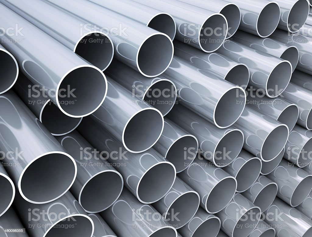 Reflective industrial tubes stock photo