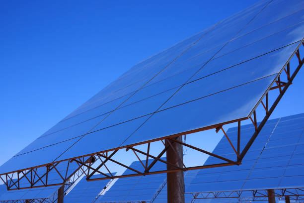 Reflective panels in a solar thermal power plant, blue sky stock photo